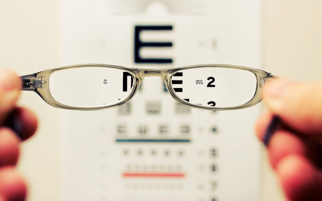 glasses showing eye-chart in focus