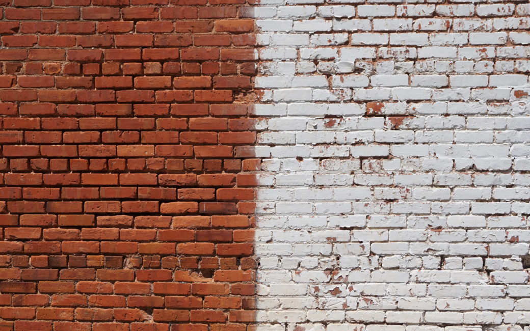 brick wall with right half painted white